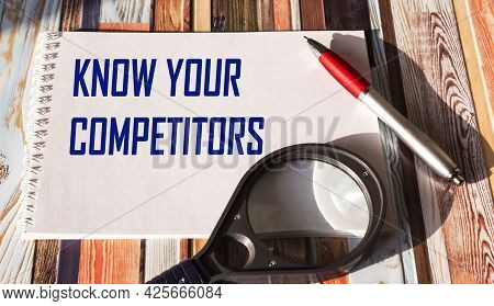 Text Know Your Competitors Business Concept Written On Notepad.