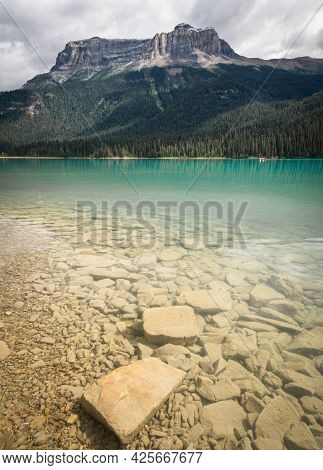 Beautiful Emerald Lake With Dominant Mountain In Background, Portrait Shot Made At Emerald Lake, Yoh