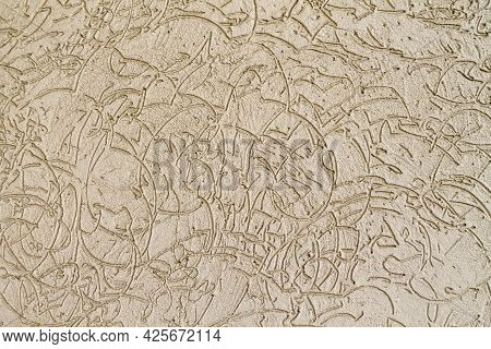 Texture Of Beige Limestone Wall With Abstract Wavy Lines Pattern