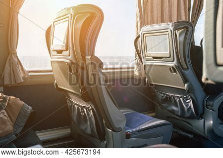 Intercity Bus Interior With Seat-mounted Interactive Touchscreen.