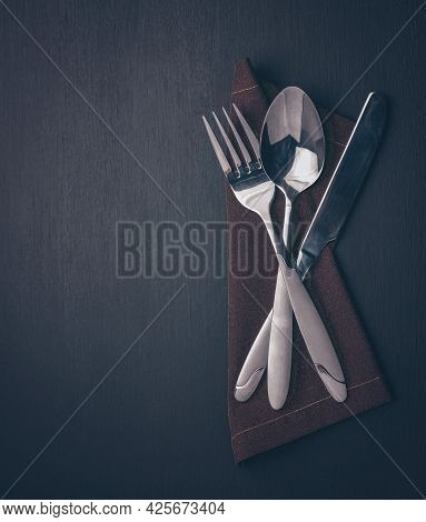 Cutlery Set-fork, Spoon, Knife, On Dark Wood. Minimalistic Still Life, Stylish Tableware. Close-up O