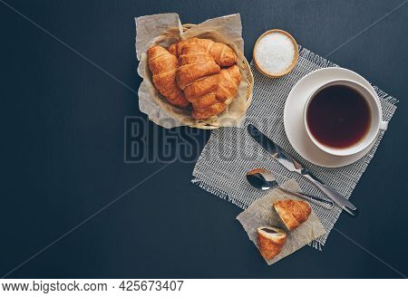 Freshly Baked Croissants On A Wooden Table. Breakfast With Croissants.tasty Croissant With Chocolate