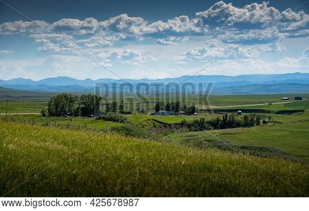 A Ranching Farm Along The Eastern Slopes Of The Canadian Rocky Mountains And Future Coal Mining Deve