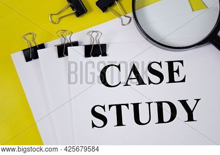 Case Study Concept Word Written On White Paper And Yellow Background With Magnifier