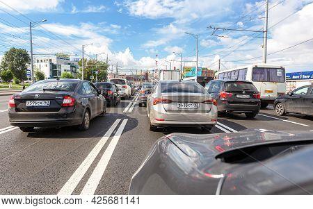 Samara, Russia - July 2, 2021: Cars Drive Along City Street With Multi-lane Traffic In Summertime