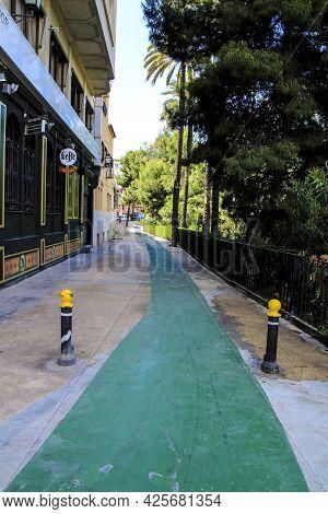 Elche, Alicante, Spain- July 3, 2021 - Bike Lane And Gardens Next To The Vinalopo River In Elche.