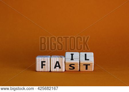 Fail Fast Symbol. Business And Design Concept. Turned Wooden Cubes With Words 'fail Fast' On Beautif
