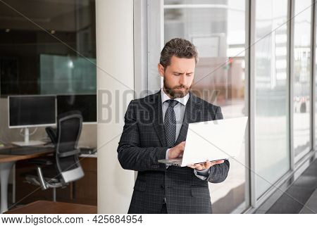 Bearded Mature Man In Suit Using Laptop At Business Office, Agile Business