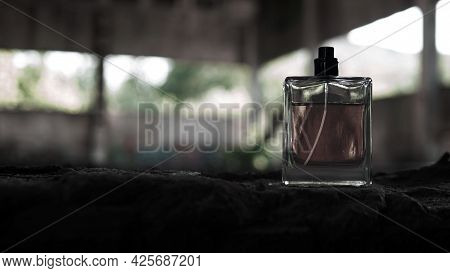 Mens Perfumes In Dark Shades. Bottle Of Men's Perfume.