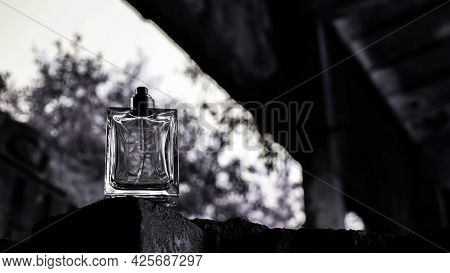 Silhouette Of A Can Of Perfume On A Black Background. Perfume For Men With Copy Space.