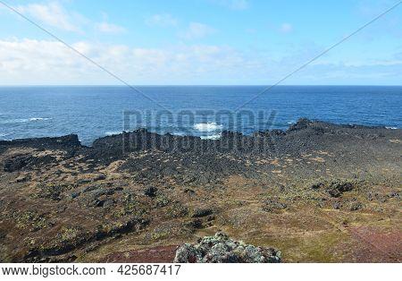 Coastal Views Of Black Lava Rock Coastline In Iceland.