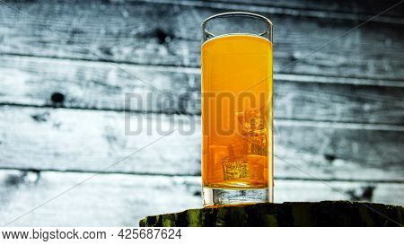 Yellow Lemonade With Ice On A Background Of Wooden Boards.