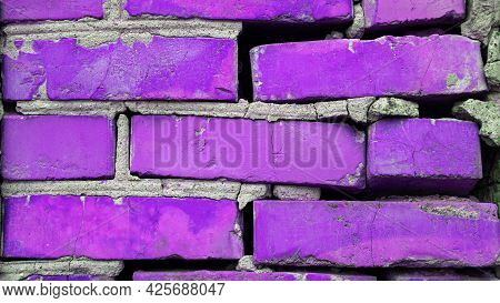 The Background Is A Purple Brick Wall, A Brick Purple Copy Space, A Colorful Old Wall.