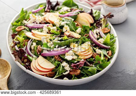 Winter Salad With Apple And Pecans With Vinaigrette Dressing