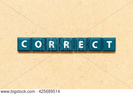 Tile Alphabet Letter In Word Correct On Wood Background