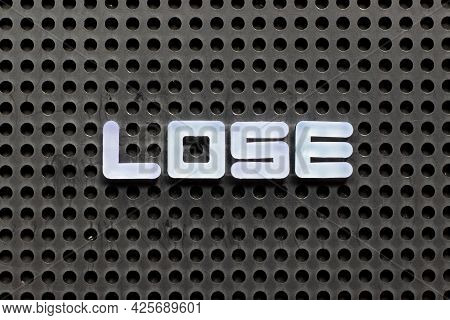 White Color Letter In Word Lose On Black Pegboard Background
