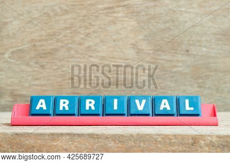 Tile Alphabet Letter With Word Arrival In Red Color Rack On Wood Background