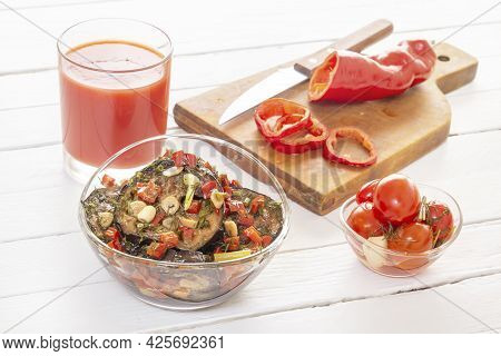 Fermented Vegetables - Eggplant In Soy Sauce In A Glass Cup With Pepper And Garlic And A Glass Of To