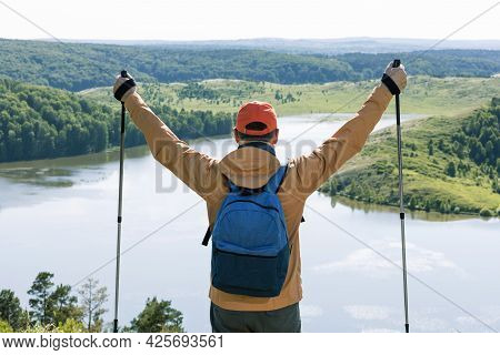 Happy Hiker Man On Top Of Mountain Near Lake.