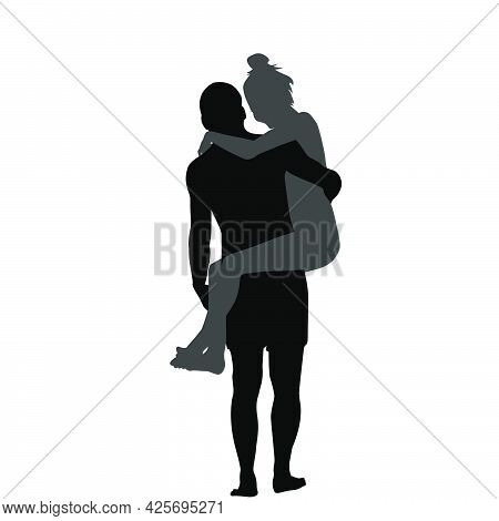 Silhouette Of Man Carrying Woman In His Arms