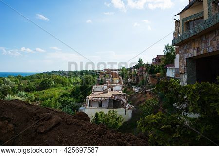 A Landslide Caused By Hurricane Rains Destroyed Expensive Cottages And Houses. A Destroyed House, A