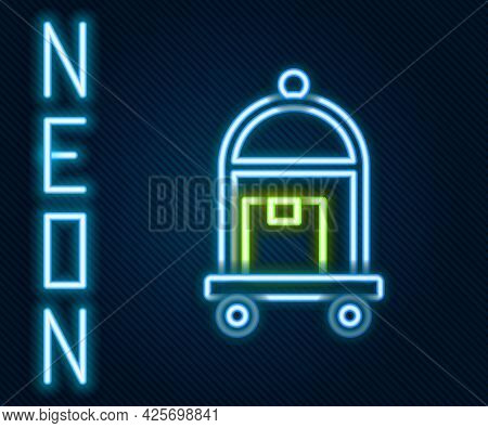 Glowing Neon Line Hotel Luggage Cart With Suitcase Icon Isolated On Black Background. Traveling Bagg