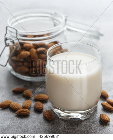 Glass With Almond Milk And Almonds On The Table