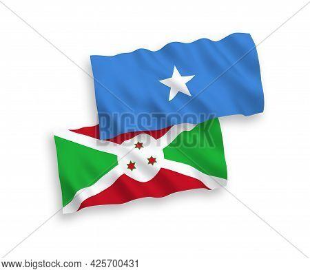 National Fabric Wave Flags Of Burundi And Somalia Isolated On White Background. 1 To 2 Proportion.