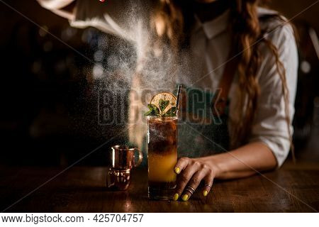 Close-up Of Glass With Coffee Cocktail And Female Bartender Carefully Sprinkles On It