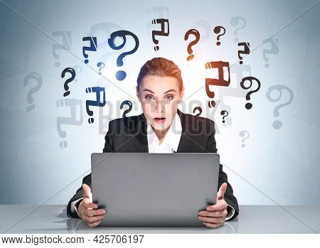 Portrait Of Amazed Attractive Business Woman In Suit Sitting At The Desk In Front Of Laptop And Pond