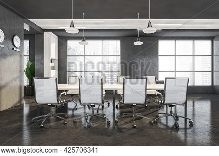 Table In The Meeting Room Interior Of Panoramic Office, Concrete Walls And Floor. Eight Office Chair