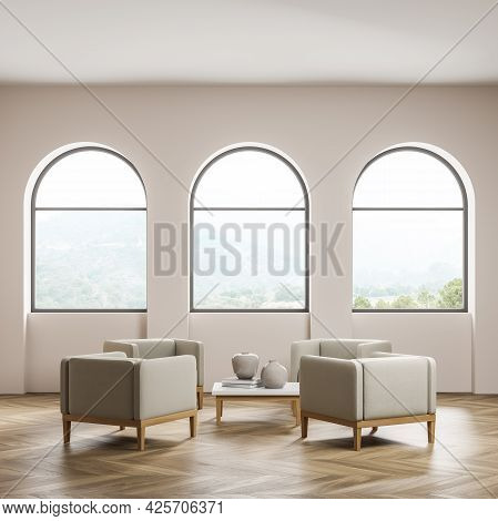 Waiting Room Interior. Thee Arch Windows With Attractive Scenery In Wall Recesses. Four Beige Armcha