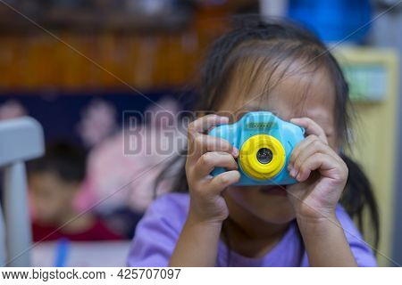 Taking Pictures Of Others. Little Girl Taking Picture Using Toy Camera, Photography Courses. Camera