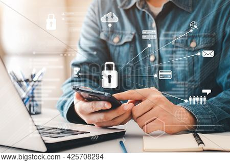 Concept Internet Security And Cyber Network. Businessman's Hand Works With A Key Icon Virtual Screen