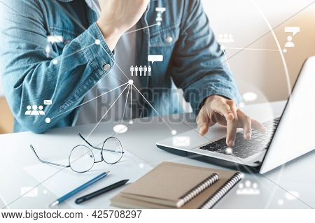 Young Man's Hand With A Laptop. A Man Who Works Remotely At Home, Ideas About The Network Or Remotel