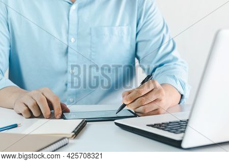 The Youngman Hands Drawing On A Digital Tablet On A Digital Tablet With An Electronic Pen. Freelance