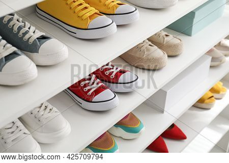 White Shelving Unit With Collection Of Colorful Sneakers