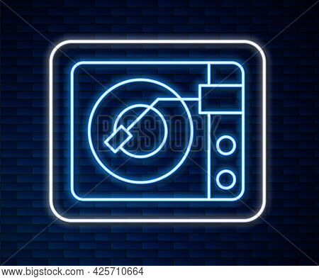 Glowing Neon Line Vinyl Player With A Vinyl Disk Icon Isolated On Brick Wall Background. Vector