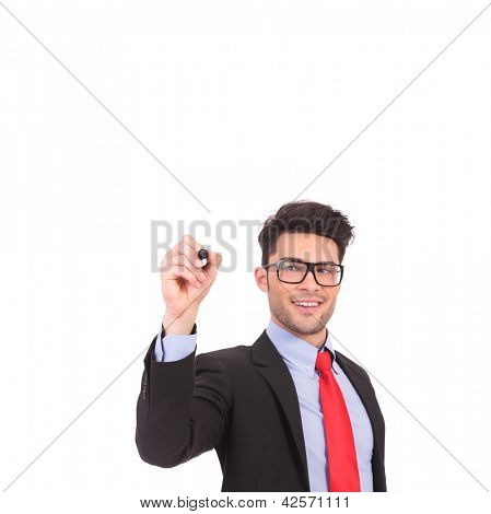 young business man writing something on an imaginary screen and smiling, isolated on white