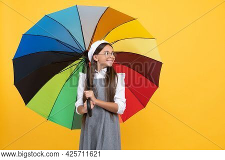 Cheerful Teen Child Under Colorful Parasol. Kid In Beret With Rainbow Umbrella.