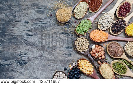 Variety Kinds Of Dry Organic Cereal And Grain Seeds In Wooden Spoon On Grunge Background, For Carboh