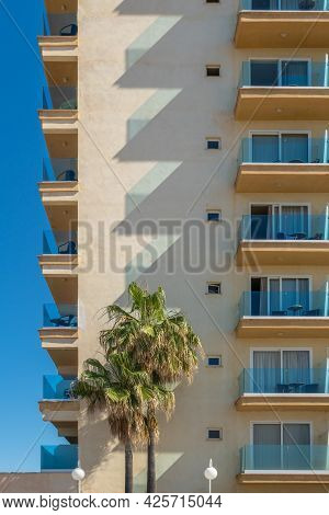 Hotel Complex Located On The Island Of Mallorca. Abstract Effect Of The Shadows Of The Balconies Pro