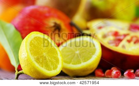 Half Lemon Slices And Berry Of Pomegranate