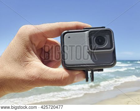 Man Hand While Holding Action Water Resistent Camera Before Filming Sport Session, Tech Devices