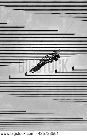 Abstract Artistic Photo Of A Male Cyclist With A Bicycle In His Hands On The Steps - Top View Overhe
