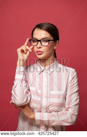 Clever Successful Young Woman Wearing Glasses On Red Background