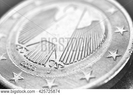 1 Euro Coin Issued In Germany Close-up. Obverse With The Federal Eagle. Light Black And White Econom