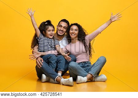 Portrait Of Happy Excited Middle Eastern Family Of Three With Little Daughter