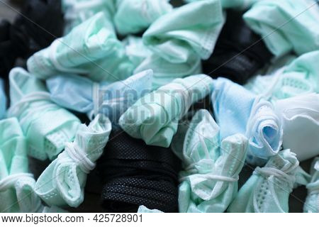 Used Disposable Hygienic Masks On The Floor. Infectious Waste, Prevented Virus Covid-19 By Separatin