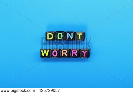 Small Black Cubes With The Word Don't Worry Colored